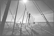 Salmon netters from Joseph Johnston & Sons of Montrose, constructing a fly net on the sands at St. Cyrus, Aberdeenshire. Fishing with fly nets here was discontinued after the 1998 season.<br /> Ref. Catching the Tide 26/97/24 (24th April 1997)<br /> <br /> The once-thriving Scottish salmon netting industry fell into decline in the 1970s and 1980s when the numbers of fish caught reduced due to environmental and economic reasons. In 2016, a three-year ban was imposed by the Scottish Government on the advice of scientists to try to boost dwindling stocks which anglers and conservationists blamed on netsmen.