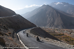 Sean Lichter, Scotty Busch and Rip Rolfsen head up to 12,000' at the end of day-5  of our Himalayan Heroes adventure riding from Kalopani through the Mustang District to Muktinath, Nepal. Saturday, November 10, 2018. Photography ©2018 Michael Lichter.