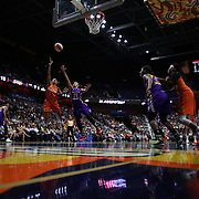 UNCASVILLE, CONNECTICUT- JULY 15:  Jasmine Thomas #5 of the Connecticut Sun shoots past Kristi Toliver #20 of the Los Angeles Sparks during the Los Angeles Sparks Vs Connecticut Sun, WNBA regular season game at Mohegan Sun Arena on July 15, 2016 in Uncasville, Connecticut. (Photo by Tim Clayton/Corbis via Getty Images)