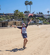 Proud American Standing on an Empty Beach in Newport During Covid19 Government Shutdown