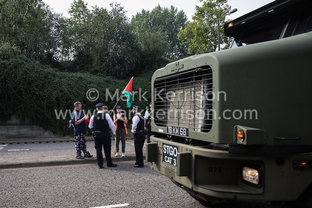 London, UK. 6th September, 2021. A large military vehicle passes as human rights activists protest outside ExCeL London against the DSEI 2021 arms fair. The first day of week-long Stop The Arms Fair protests outside the venue for one of the world's largest arms fairs was hosted by activists calling for a ban on UK arms exports to Israel.