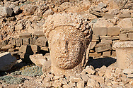 Statue head of Commagene in front of the stone pyramid 62 BC Royal Tomb of King Antiochus I Theos of Commagene, east Terrace, Mount Nemrut or Nemrud Dagi summit, near Adıyaman, Turkey .<br /> <br /> If you prefer to buy from our ALAMY PHOTO LIBRARY  Collection visit : https://www.alamy.com/portfolio/paul-williams-funkystock/nemrutdagiancientstatues-turkey.html<br /> <br /> Visit our CLASSICAL WORLD HISTORIC SITES PHOTO COLLECTIONS for more photos to download or buy as wall art prints https://funkystock.photoshelter.com/gallery-collection/Classical-Era-Historic-Sites-Archaeological-Sites-Pictures-Images/C0000g4bSGiDL9rw