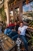 Men smoking sheesha (water pipe) at an outdoor cafe, Aqaba, Jordan
