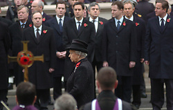 (c) London News Pictures. 14/11/2010. The Queen leds the Remembrance Sunday service at the Cenotaph in London in honour of those who have died in wars and conflicts..Pictured - The Queen prepares to lay a wreath at the Cenotaph in front of Chancellor of the Exchequer George Osbourne, Ed Miliband, Former Prime Minister Gordon Brown, Deputy Prime Minister Nick Clegg, Former Prime Minister Tony Blair and Prime Minister David Cameron