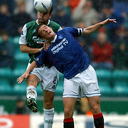 l-r; Hibernian's Grant Brebner wins possession of the ball in the air from Rangers' Barry Ferguson