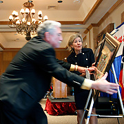 Texas Sen. Kay Bailey Hutchison reacts as Sam Vale, chairman of the Border Trade Alliance, catches a frame as it was knocked off an easel as it was presented to Hutchison during a luncheon in her honor held by the Rio Grande Valley Partnership at the McAllen Country Club. <br /> Nathan Lambrecht/The Monitor
