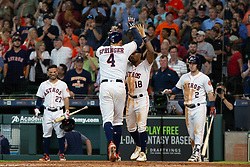 May 23, 2018 - Houston, TX, U.S. - HOUSTON, TX - MAY 23: Houston Astros right fielder George Springer (4) celebrates with Houston Astros center field Tony Kemp (18) after hitting a two-run homer in the fifth inning during MLB baseball game between the Houston Astros and the San Francisco Giants on May 23, 2018 at Minute Maid Park in Houston, Texas. (Photo by Juan DeLeon/Icon Sportswire) (Credit Image: © Juan Deleon/Icon SMI via ZUMA Press)