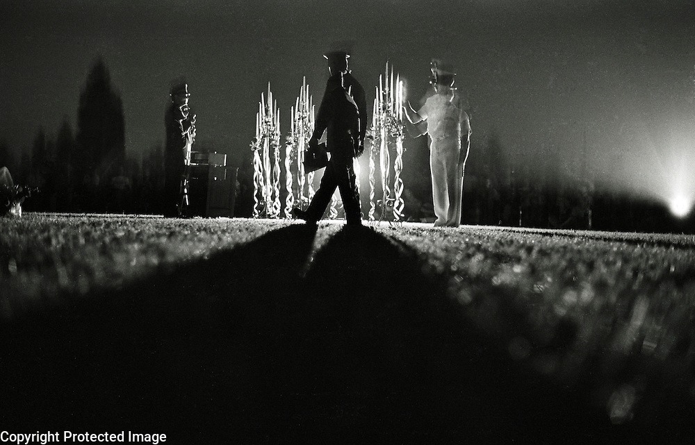 A soldier carries the names of Porterville, California area soldiers who were killed in the Vietnam War during a ceremony to dedicate a memorial to them which was installed at a park.