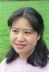 Portrait of a woman; smiling,