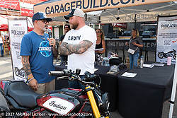 MC Jason Hallman of Torque Magazine with Seth Bowman with his custom FTR in the Dennis Kirk Garage Build bike show at the Iron Horse Saloon during the Sturgis Motorcycle Rally. Seth runs the FTR1200owners and Chiefowners social media pages. SD, USA. Tuesday, August 10, 2021. Photography ©2021 Michael Lichter.