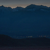 The town of Big Pine glows in California's Owens Valley, between the Sierra Nevada and Inyo Mountains (foreground.)