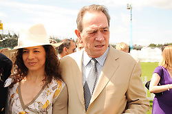 TOMMY LEE JONES and his wife DAWN at the Cartier International Polo at Guards Polo Club, Windsor Great Park, Berkshire on 25th July 2010.