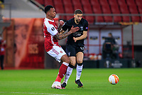 PIRAEUS, GREECE - FEBRUARY 25: Gabriel of Arsenal FC and Adel Taarabt of SL Benfica during the UEFA Europa League Round of 32 match between Arsenal FC and SL Benfica at Karaiskakis Stadium on February 25, 2021 in Piraeus, Greece. (Photo by MB Media)