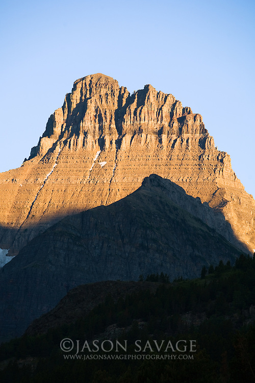 Morning light hitting peak in Many Glacier, Glacier National Park