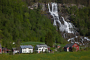Farm and waterfall near Voss, Norway.
