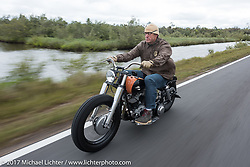 Eric Stein on his 1964 Harley-Davidson Panhead riding through Tomoka State Park during Daytona Beach Bike Week. FL. USA. Tuesday, March 14, 2017. Photography ©2017 Michael Lichter.