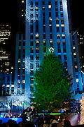 The tree, with a lightshow projecting on Rockefeller Center behind it, prior to the lighting.
