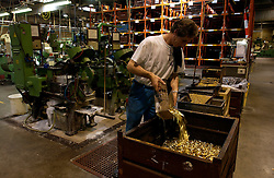 HERSTAL, BELGIUM - JUNE-13-2003 - Shell casings are cleaned and polished by special machines before being loaded with live rounds at the FN Herstal weapons fabrication plant near Liege, Belgium. (PHOTO © JOCK FISTICK)
