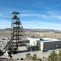 Mount Taylor Mine has two shafts, one that is 24 foot in diameter on the left which is used for hauling equipment and ore and a smaller shaft to the right solely for human use to prevent cross contamination of the air.