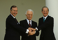 President H W Bush (Bush 41), USSR Foreign Minister Edward Shevardnaze, and Secretary of State James Baker do a three way handshake in the Rose Garden in 1989. ..Photograph by Dennis Brack, BB 29