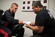 Johnny Case has his hands wrapped before his fight against Francisco Trevino during UFC 188 at the Mexico City Arena in Mexico City, Mexico on June 13, 2015. (Cooper Neill)