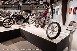 Japanese builders Yuichi Yoshizawa and Yoshikazu Ueda of Custom Works ZON's custom BMW R-18 (L) and Oliver Jones 1937/40 UL/EL custom Harley-Davidson on display in the What's the Skinny Exhibition (2019 iteration of the Motorcycles as Art annual series) at the Sturgis Buffalo Chip during the Sturgis Black Hills Motorcycle Rally. SD, USA. Friday, August 9, 2019. Photography ©2019 Michael Lichter.