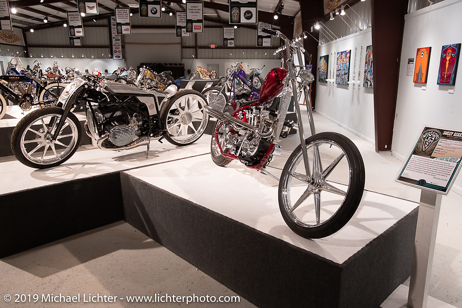 Japanese builders Yuichi Yoshizawa and Yoshikazu Ueda of Custom Works ZON's custom BMW R-18 (L) and Oliver Jones 1937/40 UL/EL custom Harley-Davidsonon display in the What's the Skinny Exhibition (2019 iteration of the Motorcycles as Art annual series) at the Sturgis Buffalo Chip during the Sturgis Black Hills Motorcycle Rally. SD, USA. Friday, August 9, 2019. Photography ©2019 Michael Lichter.