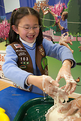 United States, Washington, Bellevue, Girl Scout (age 10) at KidsQuest Children's Museum.  MR, PR
