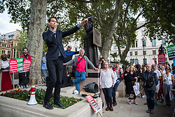 London, UK. 2 September, 2019. A speaker from the Scottish National Party addresses hundreds of people attending a 'Stop the Coup' protest in Parliament Square following Prime Minister Boris Johnson's address to the nation outside 10 Downing Street to the effect that there will be a vote on a general election if MPs vote for a further delay to Brexit.