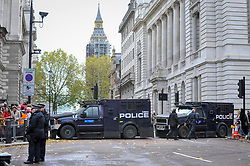 © Licensed to London News Pictures. 12/11/2017. London, UK. Armed police vehicles manage large crowds gathered around Parliament Square and Whitehall on Remembrance Sunday where members of the Royal Family, dignatories and veterans gave tributes to war dead at The Cenotaph.  Photo credit: Stephen Chung/LNP