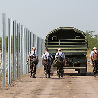 Military personnel works on the construction of a second line of border fence that is being built behind a NATO barbed wire fence to stop illegal migrants entering on the green border between Serbia and Hungary near Asotthalom (about 190 km South of capital city Budapest), Hungary on August 13, 2015. ATTILA VOLGYI