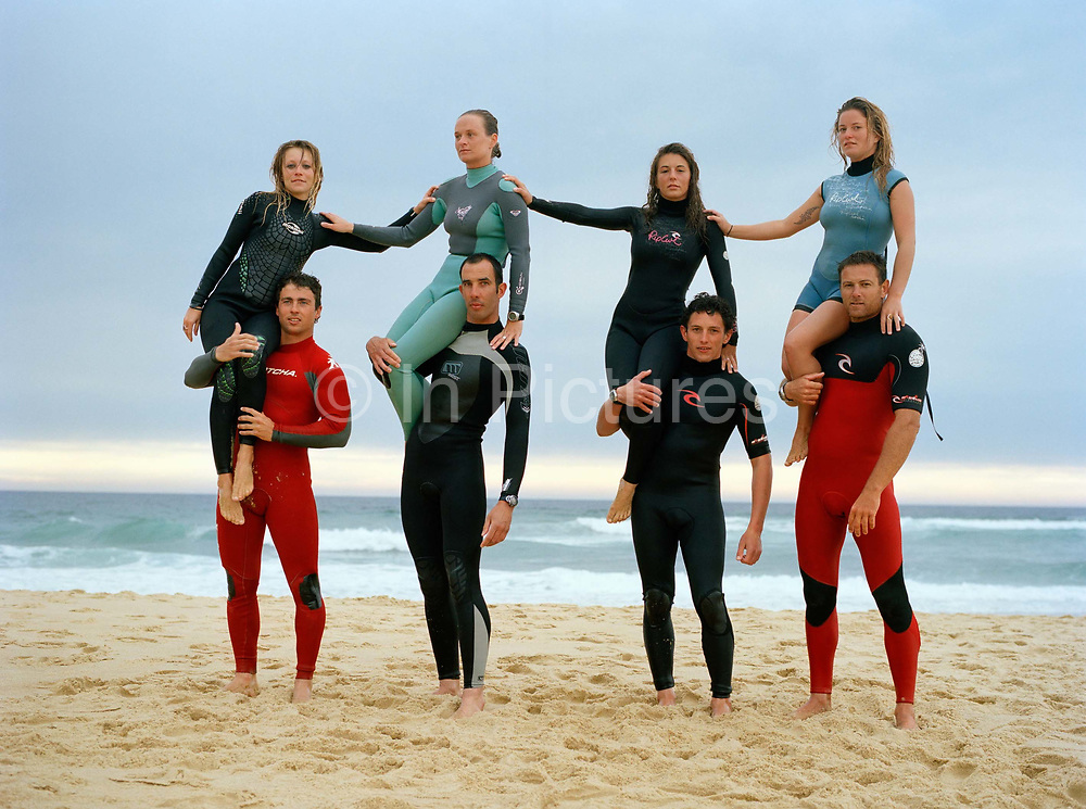 The finalists of the French leg of tandems surfing's world tour pose in Seignosse, Left to right: , Dhelia Birou, 20, and  Clement Cetran; Caroline and Loic; Jeremy Boisson, 24, and  Julie Desarnaud, 17 and finally Rico Leroy, 35,  and Sarah Burel, 19. Tandem surfing is a hybrid of surfing and acrobatics. It originated in the 1930s in Hawaii when the Waikiki Beach boys would take female tourists for rides on their boards it has since evolved into an international competition sport (run by ITSA) where couples perform complex gymnastics on surf.