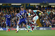 James Collins of West Ham United shoots to score his sides 1st goal to make it 1-1. Premier league match, Chelsea v West Ham United at Stamford Bridge in London on Monday 15th August 2016.<br /> pic by John Patrick Fletcher, Andrew Orchard sports photography.