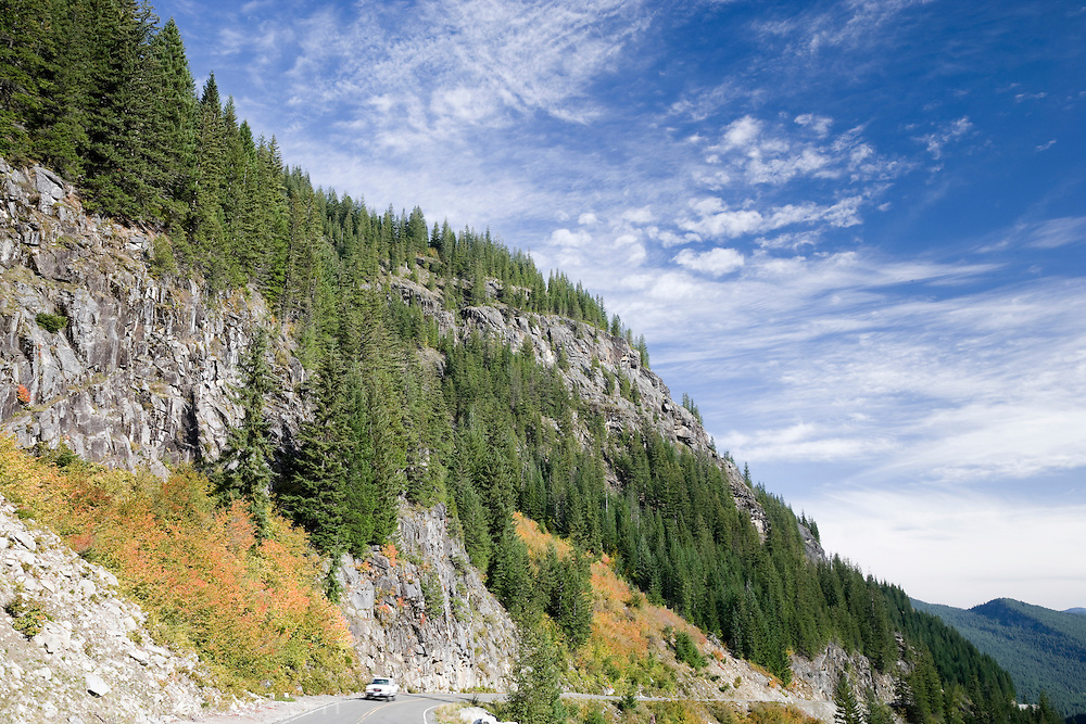 A vehicle travels the Stevens Canyon road in Mount Rainier National Park, WA, USA