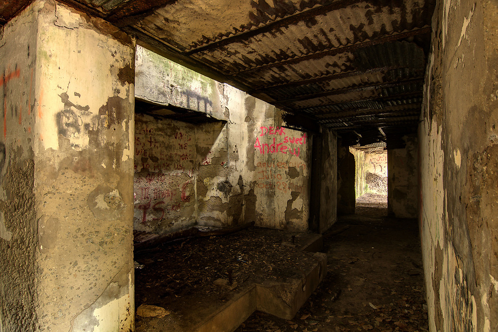 Inside the bowels of the concrete structures at Fort Fremont Historical Park in Saint Helena Island, SC on Sunday, February 22, 2015. Copyright 2015 Jason Barnette<br /> <br /> Fort Fremont consists of several concrete artillery batteries built 1898 in response to the Spanish-American War. The fort was intended to defend local Naval Station Port Royal from invading ships during the war. The fort was deactivated in 1921. Over the next eight decades the property switched hands between several private owners until 2004 when the Trust for Public Land and Beaufort County Council bought the property. <br /> <br /> Today the property is open to the public to explore the ruins of the concrete batteries. The area is only lightly maintained, and visitors enter at their own risk. However, it is a rare and thrilling place to explore.