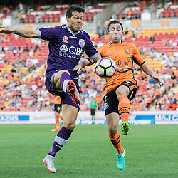 BRISBANE, AUSTRALIA - OCTOBER 30: Tommy Oar of the roar and Milan Smiljanic of the Glory compete for the ball during the round 4 Hyundai A-League match between the Brisbane Roar and Perth Glory at Suncorp Stadium on October 30, 2016 in Brisbane, Australia. (Photo by Patrick Kearney/Brisbane Roar)