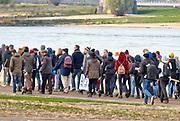 Nederland, Nijmegen, 16-11-2019 Meest zwart geschminkte pieten bij de intocht van sinterklaas. De actiegroep Kick out zwarte Piet, KOZP hield een demonstratie langs de route die zonder ongeregeldheden verliep. Er was veel politie op de been en te paard . De Sint reed op Amerigo door de binnenstad . Foto: Flip Franssen