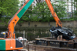 A multi-million pound dredging programme to revitalise the Olympic park waterways in underway. A 60 tonne craft has started dredging a 2.2km stretch of water from Bow Locks on Bow Creek to the Waterworks River, adjacent to the site of the Aquatics centre. The craft is expected to revoke 30,000 tonnes of silt, gravel and rubble as well as tyres, shopping trolleys and timber.Picture shows a motorcar being pulled from Bow Creek. Picture taken on 07 May 09 by David Poultney @ ODA