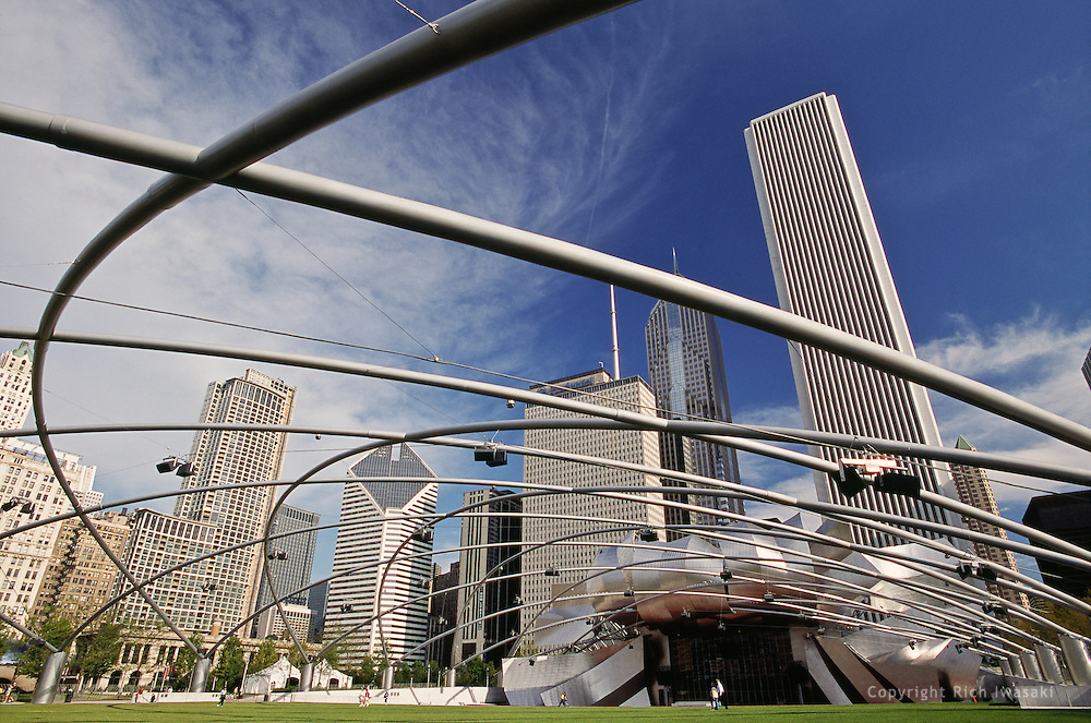 Wide angle view of Pritzker Pavilion at Millenium Park and city skyline, Chicago, Illinois