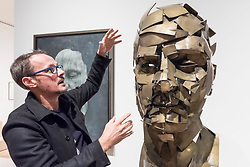 """© Licensed to London News Pictures. 07/12/2017. London, UK.  Artist Jonathan Yeo describes his work """"Homage to Paolozzi"""", 2017, created using Google's Tilt Brush virtual reality software at a preview of """"From Life"""", a special exhibition at the Royal Academy examining what making art from life has meant to artists throughout history and how the practice has evolved as technology opens up new ways of creating artworks.  The exhibition runs 11 December to 11 March 2018.  Photo credit: Stephen Chung/LNP"""