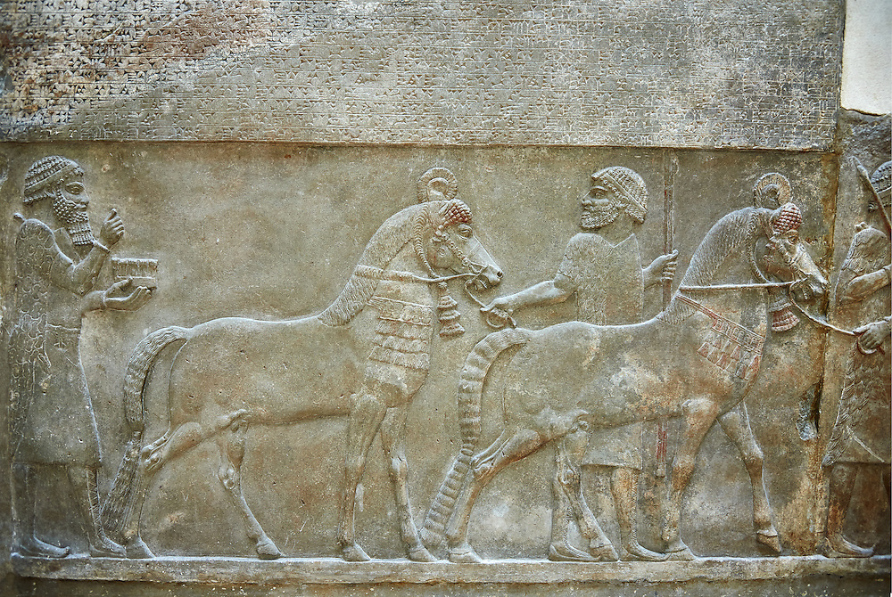Stone relief sculptured panel of horses and soldiers from corridor 10. Facade L. Inv AO 19918 from Dur Sharrukin the palace of Assyrian king Sargon II at Khorsabad, 713-706 BC.  Louvre Museum Room 4 , Paris .<br /> <br /> If you prefer to buy from our ALAMY PHOTO LIBRARY  Collection visit : https://www.alamy.com/portfolio/paul-williams-funkystock/ancient-assyria-antiquities.html  Refine search by adding background colour, place, subject, museum etc into the LOWER SEARCH WITHIN GALLERY box to <br /> <br /> Visit our ANCIENT WORLD PHOTO COLLECTIONS for more photos to download or buy as wall art prints https://funkystock.photoshelter.com/gallery-collection/Ancient-World-Art-Antiquities-Historic-Sites-Pictures-Images-of/C00006u26yqSkDOM
