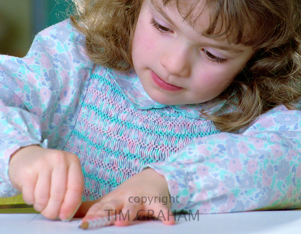 A six year old girl drawing