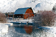 Snow covered rustic barn along Flat Creek in the Jackson Hole valley.