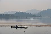 Fisherman in his canoe fishing, Loktak Lake, Moirang, Manipur, India