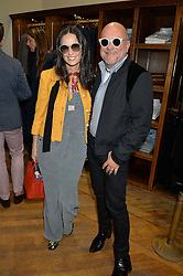 DEMI MOORE and ERIC BUTERBAUGH at a private view of photographs by Gray Malin 'Beaches' held at Huntsman, 11Savile Row, London on 20th June 2016.