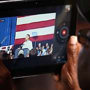 A supporter uses an iPad to videotape President Barack Obama as he speaks during his Grassroots event at the Kissimmee Civic Center in Kissimmee, Florida on Saturday, September 8, 2012. (AP Photo/Alex Menendez)