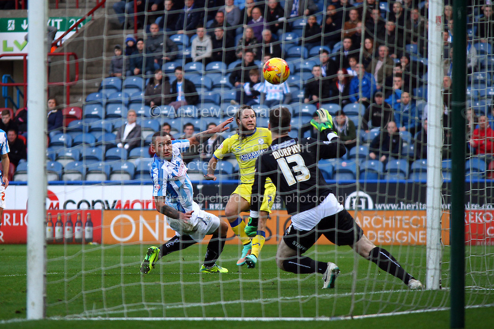Stevie May of Sheffield Wednesday sees his shot go over the bar. Skybet football league championship match, Huddersfield Town v Sheffield Wednesday at the John Smith's stadium in Huddersfield, Yorkshire on Saturday 22nd November 2014.<br /> pic by Chris Stading, Andrew Orchard sports photography.