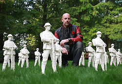 EDITORIAL USE ONLY<br /> Artist Mark Humphrey looks at his piece 'Lost Armies' on display at Jubilee Park in LondonÕs Canary Wharf, as part of the UKÕs first Remembrance Art Trail in association with The Royal British Legion, which opens free to the public on Tuesday November 1 for two weeks.