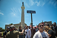"""A group of people gathered at Lee Circle in the morning to take a stand against the  """"Antifa"""" and show support for keeping New Orleans Confederate monuments in tact. White suprmists also turned out to counter protest against Take 'Em Down NOLA, a group celebrating the removal of the confederate monuenets. Four Confederate monumnets were approved to be removed. So far only one has been."""