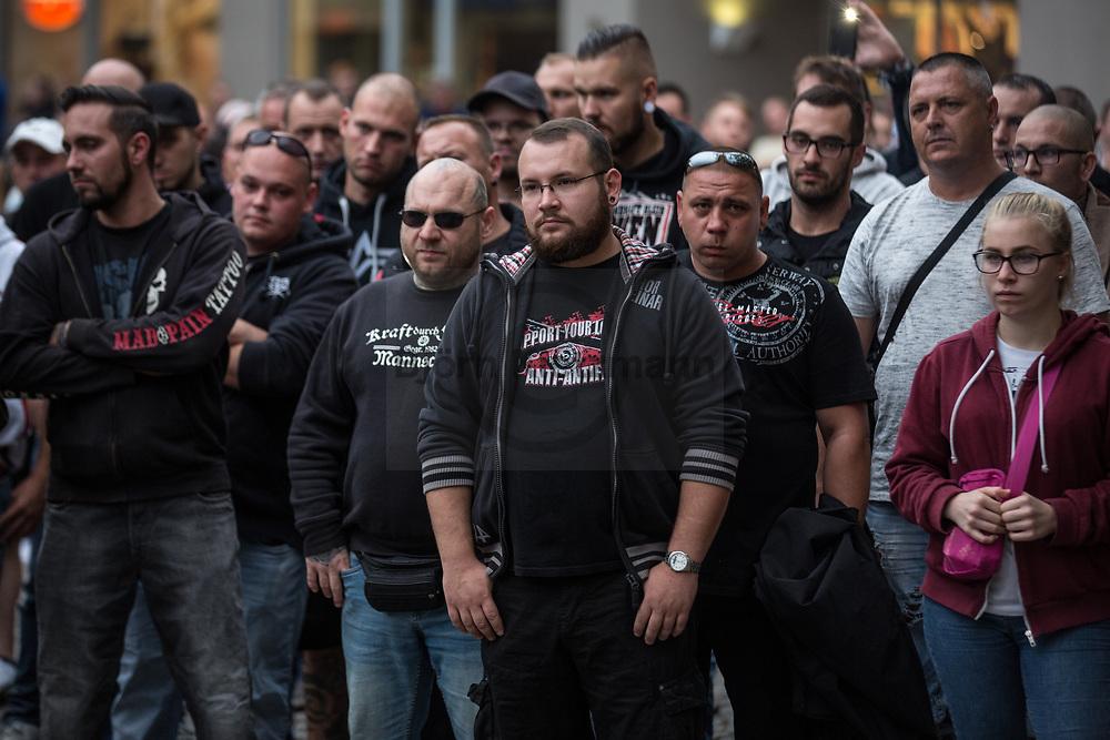 Koethen, Germany - 10.09.2018<br /> <br /> About 100 people took part in a far right wing Monday demonstration in Koethen (Sachen-Anhalt) before the beginning of the AfD mourning march. A 22-year-old man died after an argument on Sunday night. Police have arrested two suspected Afghan men on suspicion of bodily injury resulting in death. <br /> <br /> <br /> Etwa 100 Menschen nahmen vor dem Beginn des AfD-Trauermarsch an einer Montagsdemo-Kundgebung in Koethen (Sachen-Anhalt) teil. Nach einer Auseinandersetzung in der Nacht zum Sonntag verstarb ein 22-Jaehriger Mann. Die Polizei hat 2 tatverdaechtige afghanische Maenner wegen dem Verdacht auf Koerperverletzung mit Todesfolge festgenommen. <br /> <br /> Photo: Bjoern Kietzmann